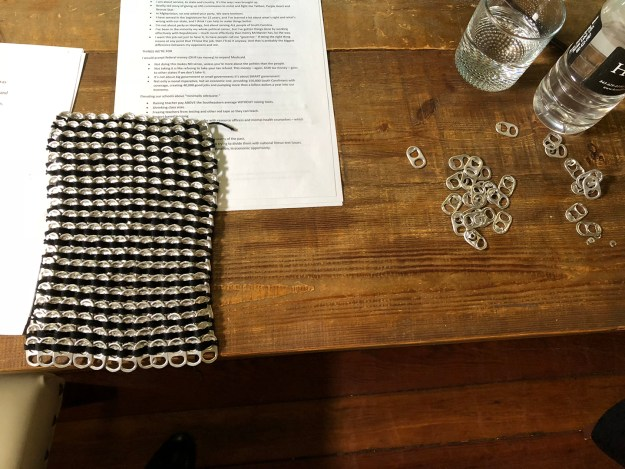 A completed part of the dress Kirkland was working on, sitting on the table in the hotel suite. At top you see a memo of talking points I had put together for the debate. Not that James needed it. He knew what his talking points were.