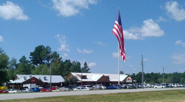 This is a view of the giant American flag in the parking lot of Shuler's BBQ.