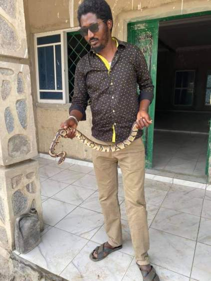 See Photos As A Nigerian Got Bitten By His Snake Pet