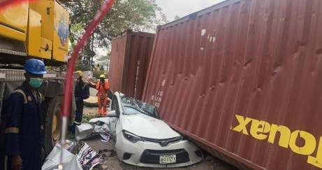 See Photos As Container Falls And Crushes Car Parked Within The Premises Of A School In Lagos