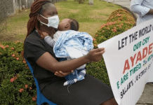 See Photo As Cross River Magistrate Joins Others With Her 5-Month-Old Baby To Protest At Gov Ayade's Office Over Unpaid 26-Months Salary