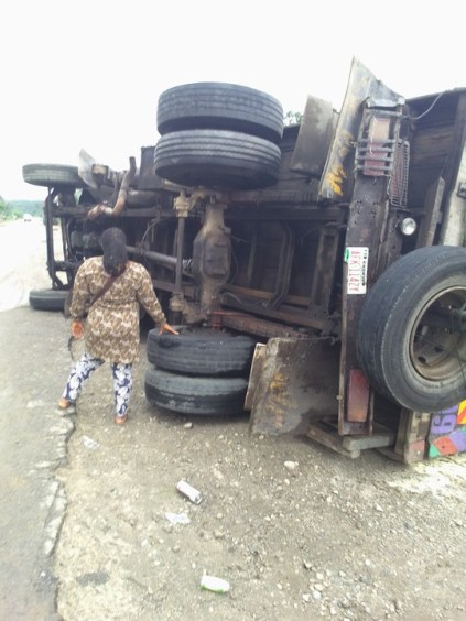 See Photos As Truck Falls On Odukpani Road In Cross River State
