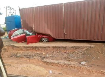 Occupants Escape Unhurt As Container Falls On Vehicle In Lagos