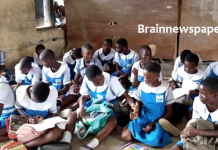 See Photo As Students Sit On Floor, Windows To Learn In Delta School