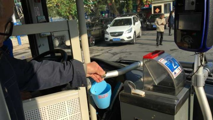 China Offer Coins For Bus Passengers