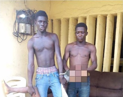 Police Parade Brothers With Human Head After Beheading 10-year-old For N200k