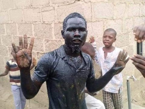 Man Fulfills His Promise, Bathes In A Gutter To Celebrate Buhari's Victory