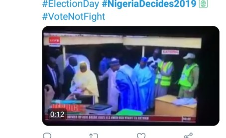 President Buhari Provokes Laughter As He Peeps Through Aisha's Ballot Paper