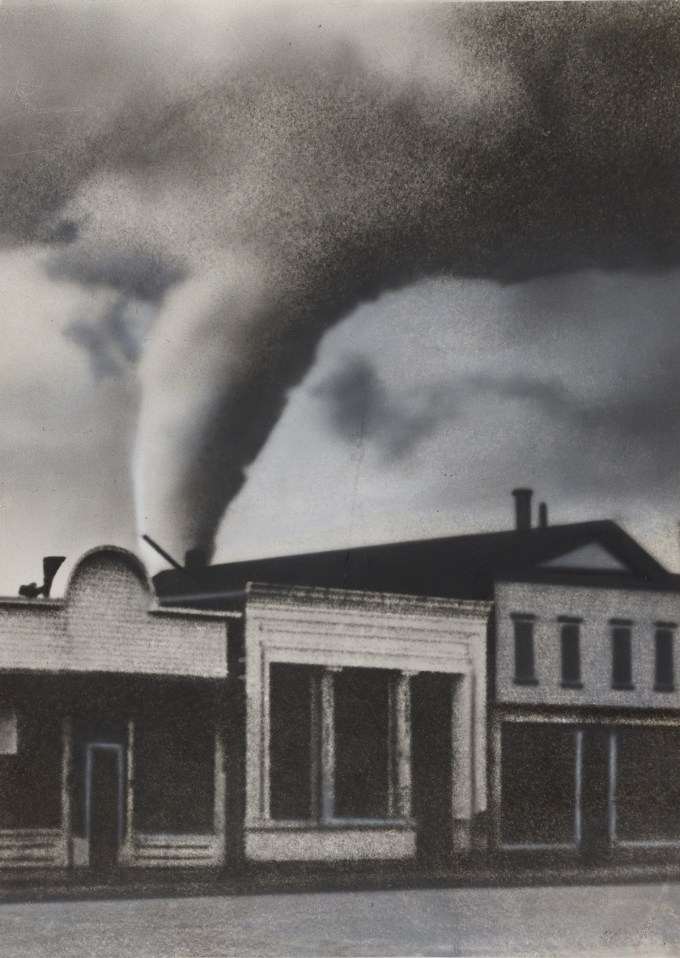 "International News Photo: ""The Portent of Coming Disaster: A Tornado, Photographed as It Moved across the Sky toward White, S.D., by a Cameraman Who Was the Only Person Who Did Not Take Shelter in a Cyclone Cellar. None of the Buildings Shown in the Picture Was Damaged, as They Were Not in the Direct Path of the Tornado,"" 1938. (Courtesy of The Museum of Modern Art, New York. The New York Times Collection. © 2016 International News Photo)"