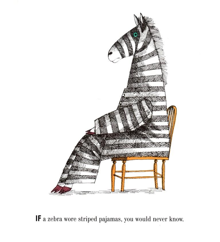 a zebra sitting in a chair