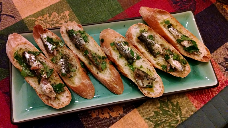 [image: toasts with marinated anchovies]