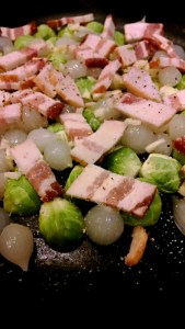 [image: uncooked mess of brussels sprouts, pearl onions, and bacon]