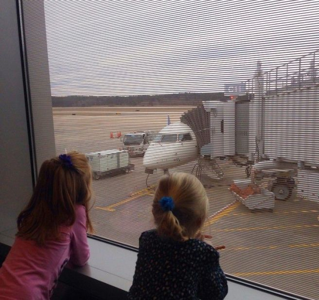 girls watching plane