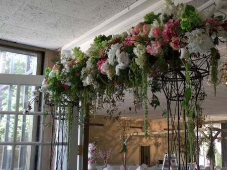Flower covered wrought iron arch