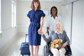 Lady in a wheelchair with carer