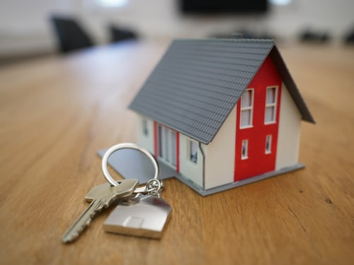 Image of home with a key