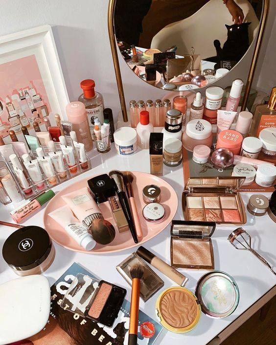 Pink beauty products on bathroom table, makeup, skincare and