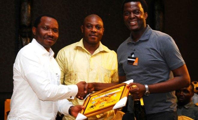 From left: General Manager, Consumer Marketing, MTN, Kola Oyeyemi; Coach Steven Keshi and Winner, Most Valuable Fan Award, Branch Manager FCMB, Abiodun Adigun, at MTN Football Hub, held at Oriental Hotel, Lekki, Lagos…