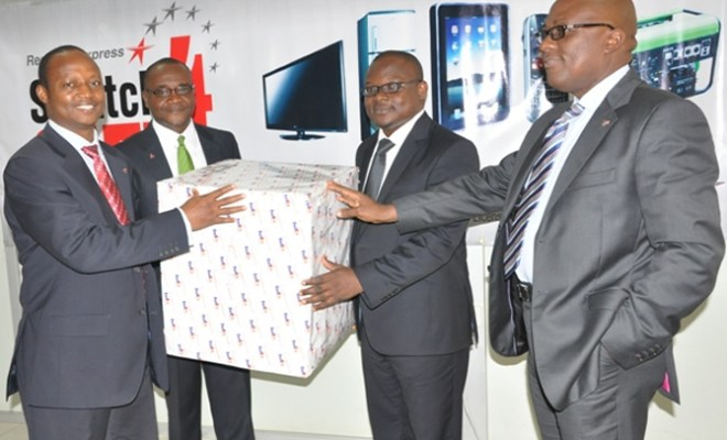 Managing Director RedStar Express Plc, Mr Sule Bichi, Deputy General Manager, Key Account and Marketing, Mr Victor Ukwat, One of the Winners of the promo, Mr Bankole Adeniyi of VDT Communications Limited and the Executive Director, RedStar Express Plc, Mr Muyiwa Olumekun at the presentation of gift to the winners in Lagos