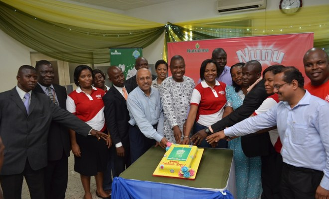 Officials of Nutricima and Ikorodu North LCDA cutting the Children's Day cake May 28 at Nutricima Schools debate