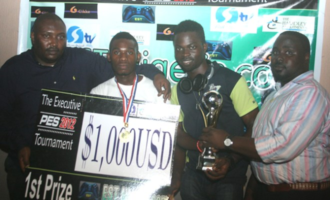 l-R: BBC Sport Analyst, Mr. Tony Eboh; Shedrack of Deftone United; Kasim Dipo, best player and Team Manager, Deftone United, Mr. Ayodeji Akinso, during the price presentation to winners at the 2012 Electronic Sports Competition in Lagos.