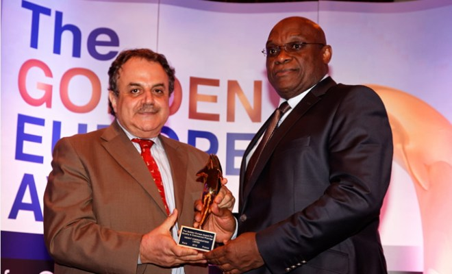 Presentation of the Golden Award by Charles S. Tabet, President/CEO of Association Otherways Management and Consulting - France to Jimi Awosika, MD/CEO Insight