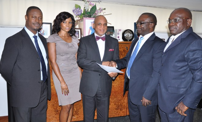 """Biodun Sobanjo, Chairman Troyka Group (middle) receiving a congratulatory letter from Chido Nwakanma, Vice President, Public Relations Consultants Association of Nigeria (PRCAN) during the association's recent visit to The Quadrant Company to celebrate its winning the Sabre Awards """"African Consultancy of the Year 2012"""". With them are Bolaji Okusaga, Managing Director of The Quadrant Company, Dolapo Adeyemi, PRCAN Executive Secretary, and Muyiwa Akintunde, PRCAN's Assistant General Secretary."""