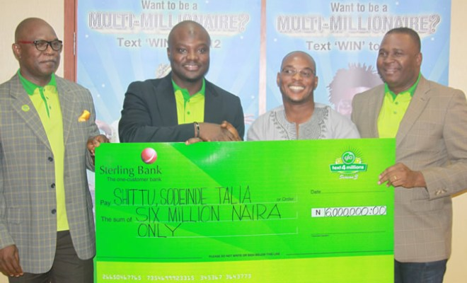 Globacom's Head of Value Added Services, Samson Isa (right), presenting a cheque of N6 million to Shittu Shodeinde Talia, a lucky winner in the Glo
