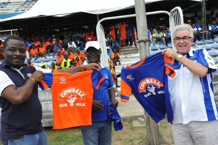 L-R : Commercial Director, Promasidor Nigeria, Kachi Onubogu, Rector Cowbell Football Academy, Godwin Dudu-Orume and Managing Director, Promasidor Nigeria, Chief Keith Richards unveiling the new Cowbell Football Academy Jersey
