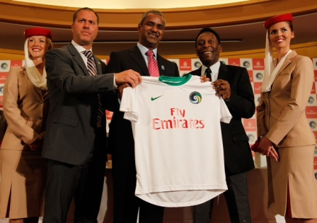 (L-R) Giovanni Savarese, New York Cosmos Head Coach; Nabil Sultan, Emirates Airline Divisional Senior Vice President of Revenue Optimization and Distribution; and Pelé, New York Cosmos Honorary President revealing the jersey