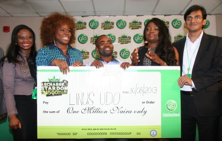 "A winner of N1 million in the ongoing Glo ""Recharge to Stardom"" promo, Tayo Attah (middle), a Kaduna-based nurse, collecting her cheque from Glo ambassadors, Funke Akindele and Omawumi during the prize presentation ceremony held on Friday in Lagos. With them from left is Mrs. Abimbola Umozurike of Glo Customer Care, and the GM, Consumer Marketing, Ashutosh Tiwary."