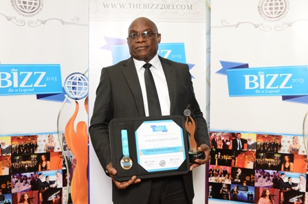 Jimi Awosika, Managing Director, Insight Communications displays the award plaque