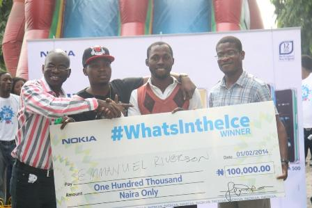 L-R: Retail Marketing Manager, Nokia West Africa, Mr. Olajide Adeyemi; star rapper, Olamide; N100,000 winner of the What's In the Ice competition, Mr. Emmanuel Riverson, and Communications Manager, Nokia West and Central Africa, Mr. Airiafo Oriunuebho during the launch of the new Nokia Asha ICE