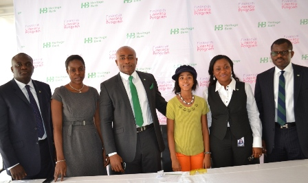 From left, CIBN Representative , Mr. Tade Fadare; CBN Representative,Mrs Bunmi Adebiyi;Group Head- Customer Experience and Analytics, Heritage Bank, Mr. Raphael Omoregie; the Heritage Bank Financial Literacy Brand Ambassador,Miss Zuriel Oduwole ,Executive Director- Ivory Banking, Heritage Bank , Mrs. Mary Akpobome and Executive Director, Manila Banking, Heritage Bank, Mr. Niyi Adeseun during the Launch of Heritage Bank Financial Literacy program