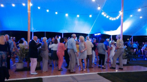 people dancing to live band at fundraiser