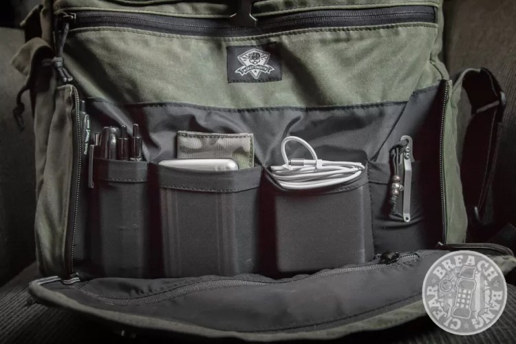Grey Ghost Gear Wanderer messenger bag front pockets with quick-access pockets held a laptop power adaptor, business cards, med kit, pens, beard comb, sharpies