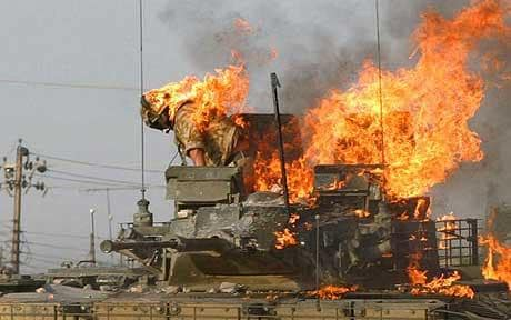A tank crewman bails out of burning armored vehicle during fighting in Iraq.