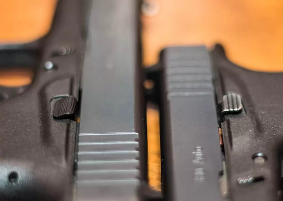 Vickers slide stop, left, next to an original on a G42