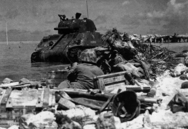 M4 Colorado supporting Marine infantry on Red Beach 3 at Tarawa.