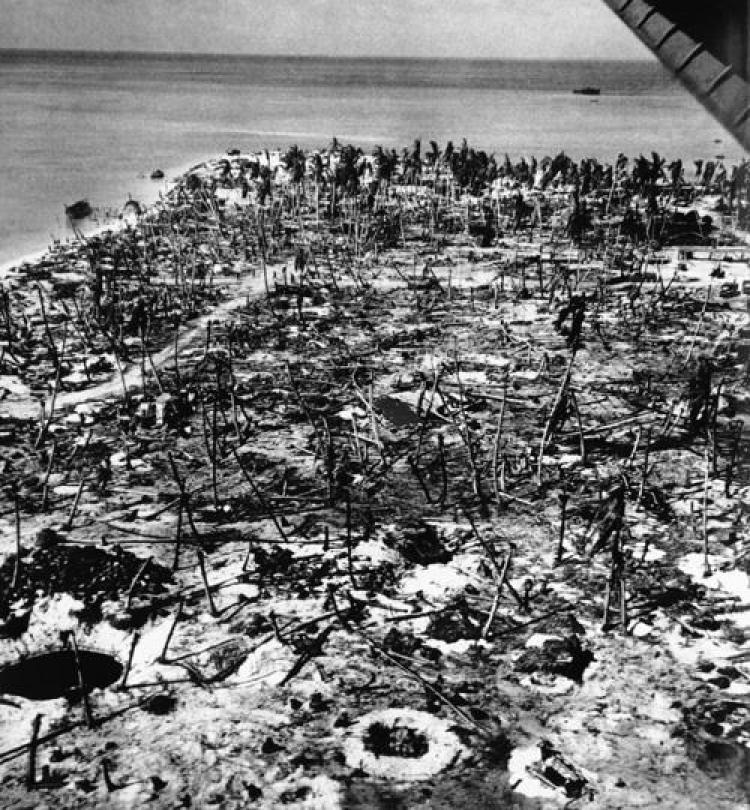 "Sherman tank ""Commando"" knocked out by Japanese anti-tank gun during the Battle of Tarawa."