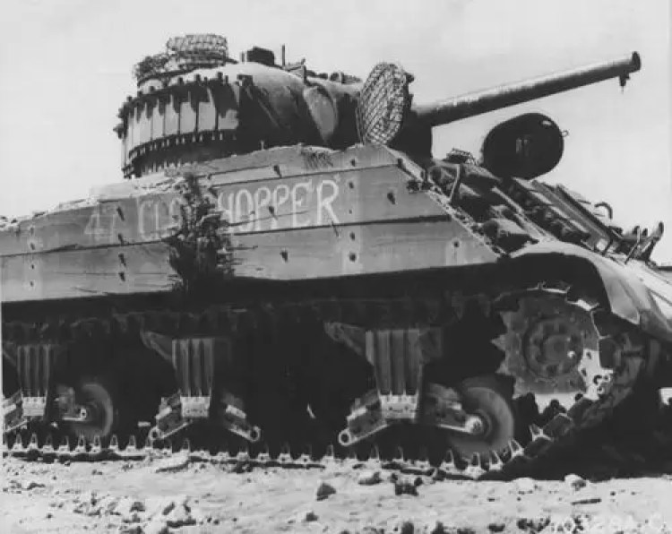 Wood planks and wire cages were put on Sherman tanks to help defend against magnetic mines and satchel charges.