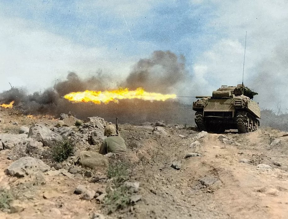 A Sherman M4A3R3 'Zippo' Flamethrower tank in action on Iwo Jima March 1945; US Army Signal Corps