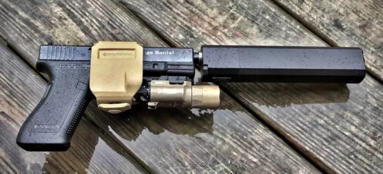 """suppressor holster - As Crye describes it, the Gun Clip is, """"...an entirely new approach to carrying and deploying a handgun. Any light, any suppressor, any platform, any orientation, any situation."""" -Image source, The Firearm Blog."""