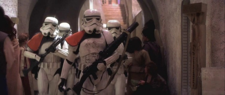 """Guns of Star Wars: The Sandtrooper in the middle carries the BlasTech T-21 Light Repeating Blaster. Perhaps it was called """"light"""" due to the fact that Lewis Gun was officially designated at """"light machine gun,"""" and was carried by a single soldier during the First World War."""