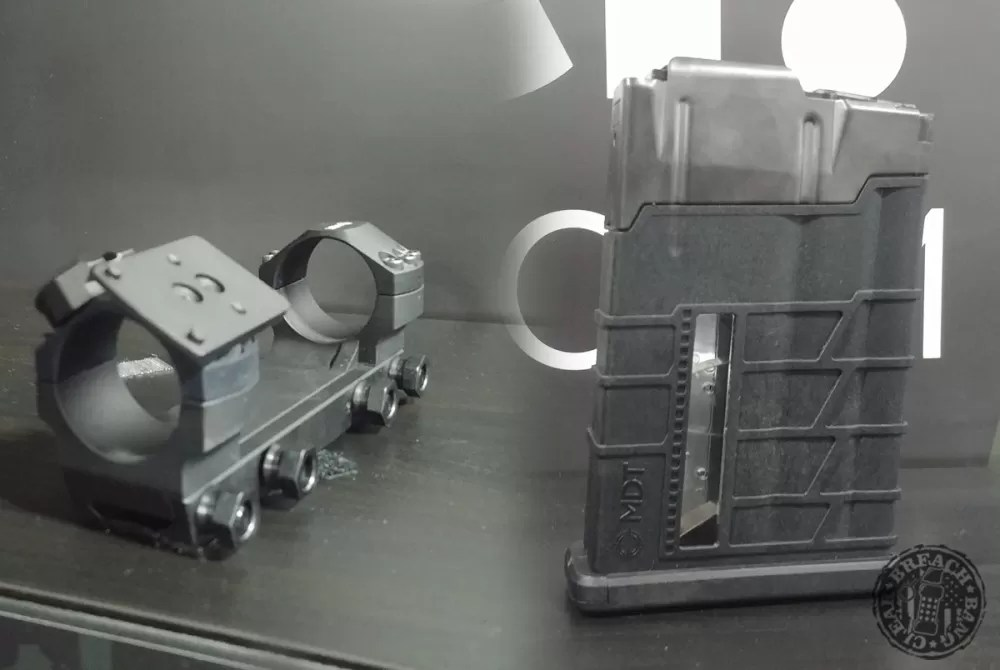 MDT One Piece Scope Mount With Accessories On The Left and MDT Poly/Metal Short Action Magazine On The Right