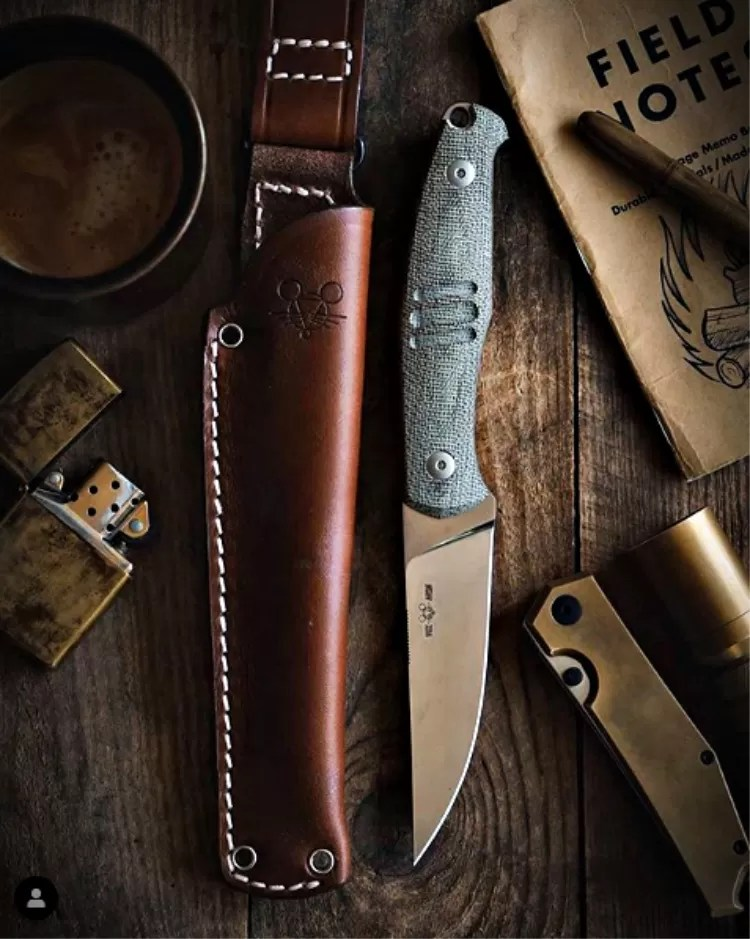 """GM says it """"Screams tool, feels cool."""" The GMF2-FF features M390 steel, full flat grind, micarta handle and a leather sheath that is a piece of art on it's own"""