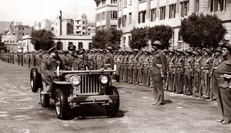 """King Farouk I of Egypt inspecting army units in Abdeen Square in the early 1950s. The Egyptian Army looks rather """"British"""" and is still armed with a mix of British Lee Enfield and German Mauser bolt action rifles."""