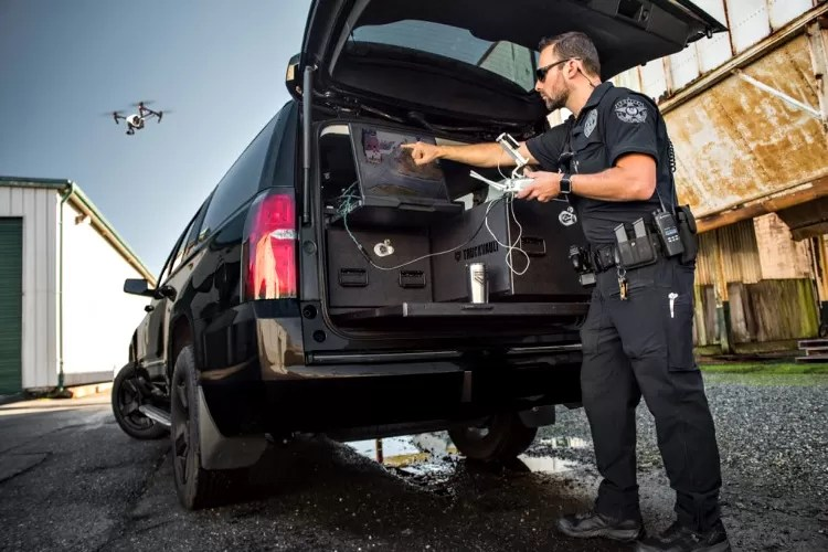 TruckVault storage system in SUV - officer operating drone.