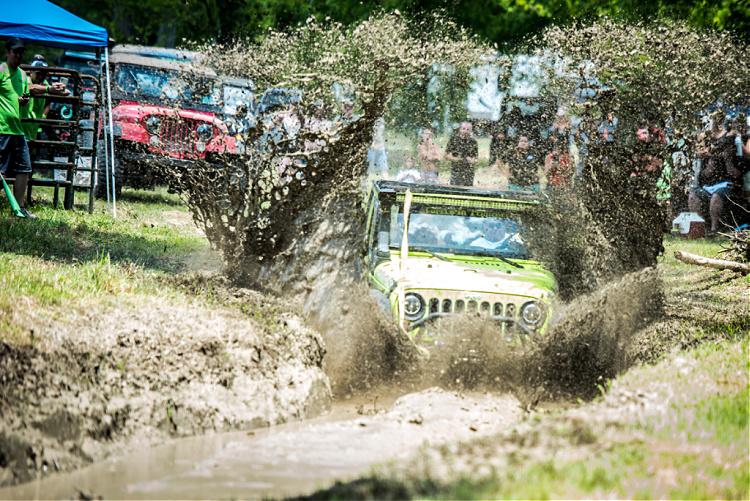 Jeep splashing into TrailJam mud bog.
