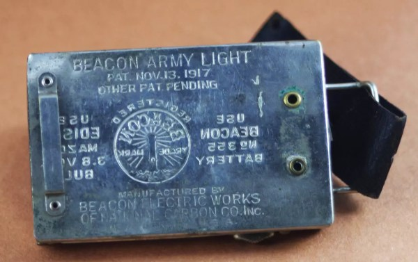 The WWI era Beacon Army Light has a leather strap that uses a 1/2 in. US Army brass button for closure.